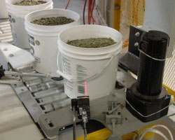 EACH PAIL OR VACUUM BAG IS SCANNED FOR LABELING ACCURACY